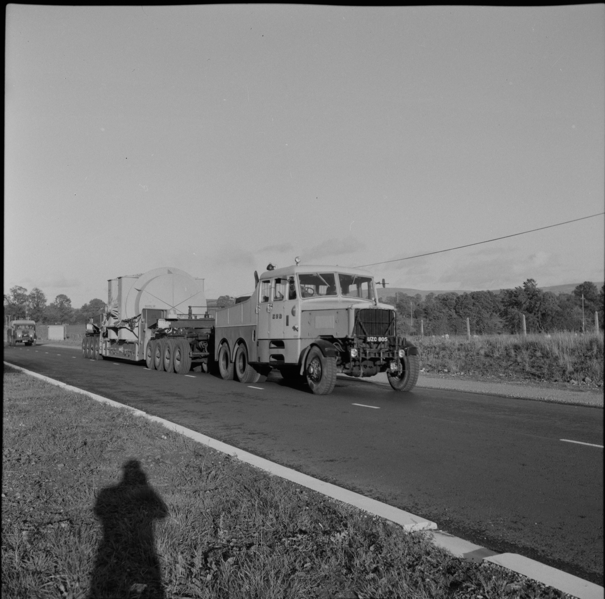 Casts a long shadow!  An ESB tractor and wide load on the Naas Road.