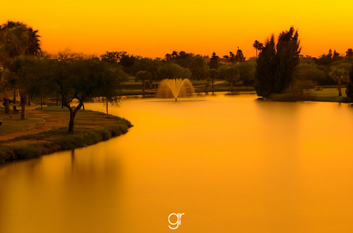 longexposure sunset orange lake texas calm waterfountain brownsville southtexas