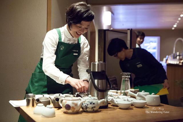 Female staff member preparing the Sencha teas for the workshop