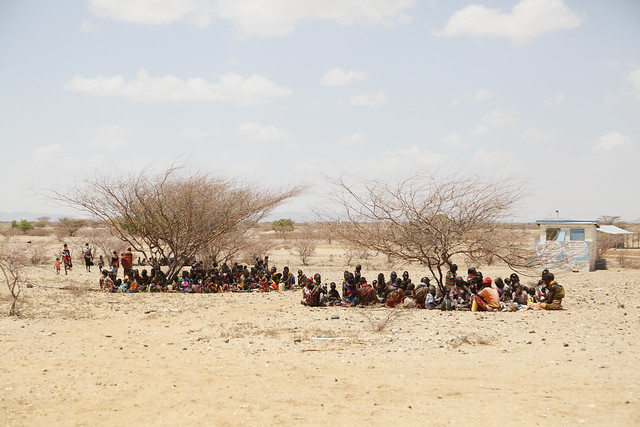 Women and children try to shelter from the sun at a health clinic in Kapua, Turkana County, northwest Kenya, 29 January 2017.