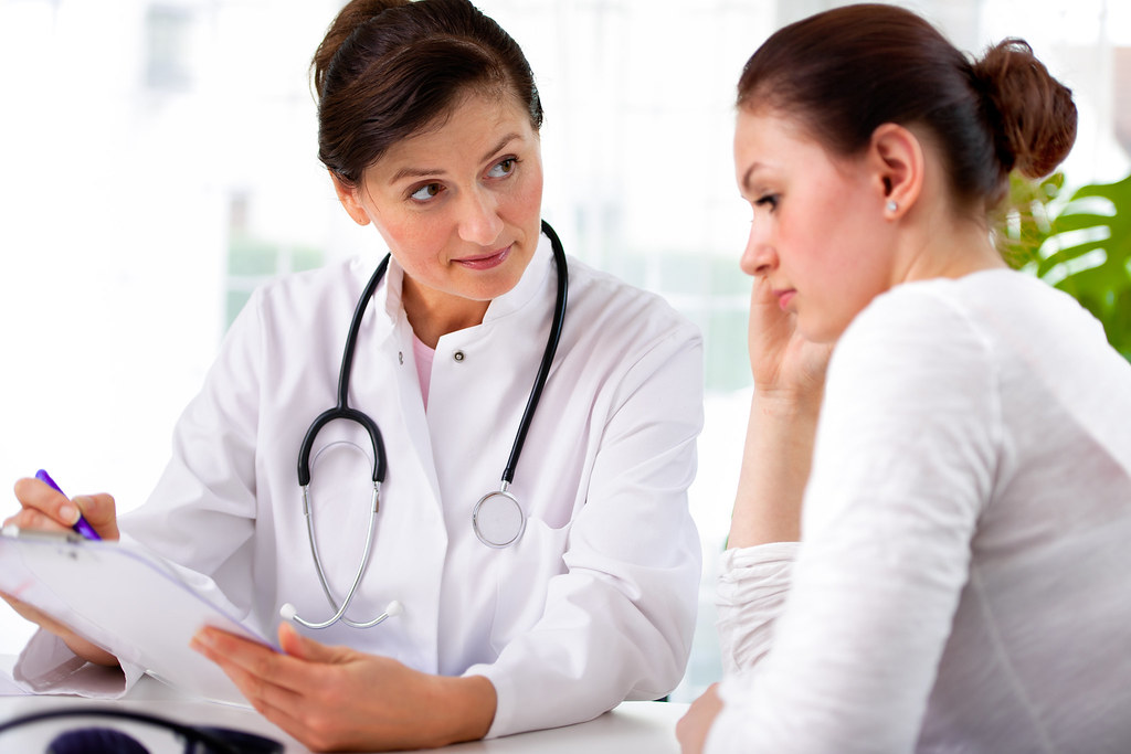 doctor with female patient | doctor explaining diagnosis to … | Flickr