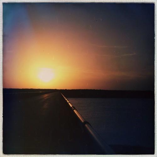bridge sunset sun silhouette landscape vanishingpoint sunrisesunset southend iphoneography hipstamatic foxylens oggl hipstaconnect lampassasriverbridge hipstaweekly pureoggl robustafilm
