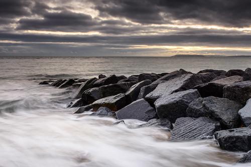 uk sunset seascape rocks december shingle haylingisland hampshire lee nd filters grad southcoast greyclouds sandypoint greyness nikond800 swirlingsea sunsetsnapper