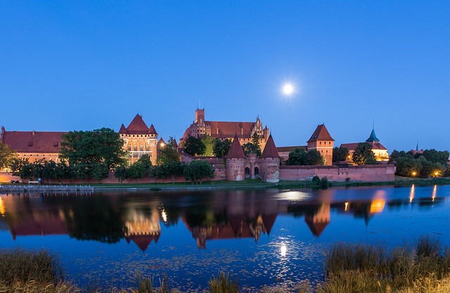 Fairytale moonrise over Malbork Castle, Poland (UNESCO world heritage site)