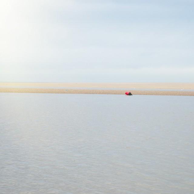 Buoy, sand, sea