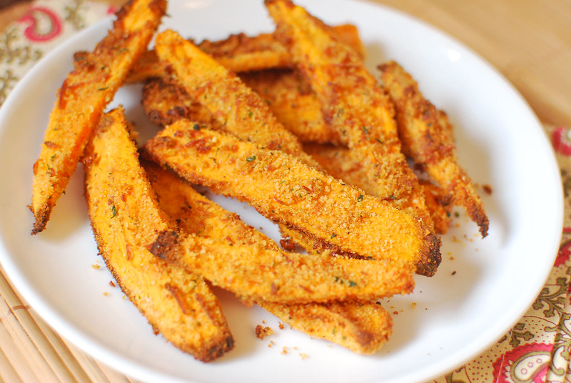 Parmesan-Crusted Sweet Potato Fries - crunchy sweet potato fries without frying! The sweet potatoes are coated in butter, bread crumbs, and Parmesan cheese for the perfect sweet and salty, crispy side dish!