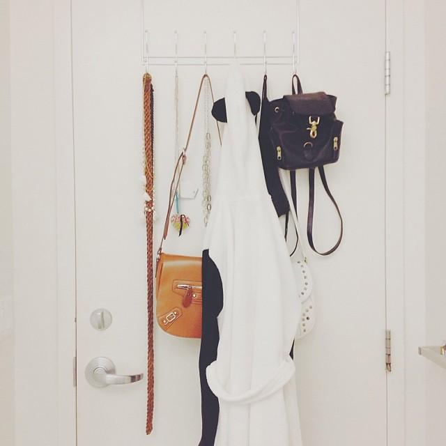 The back of my door is ridiculous... no not really. #panda #bathrobe #bags #purses #backpack #belts #accessories #uwaterloo #residence #university #dorm #door #jewellery #necklaces #vscocam #vsco #unilife #reslife #school #suite