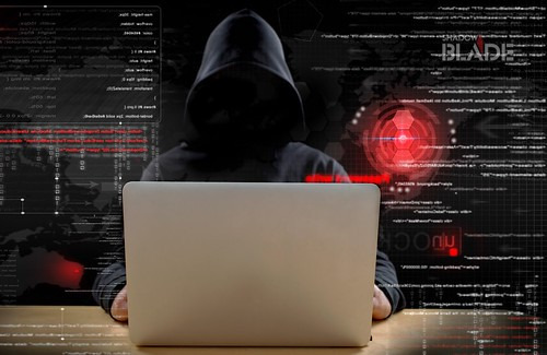 hacker at work with graphic user interface around | by matbaasayfasi.com