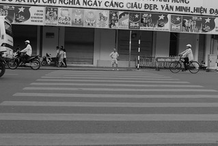 mind the motorcycles and commit while you cross   by nubianomad