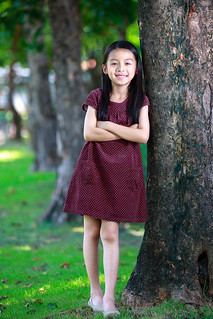 Happy young asian girl standing near a tree in a park | by Patrick Foto ;)