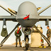 Airmen with the 49th Aircraft Maintenance Squadron tow an MQ-9 Reaper remotely piloted aircraft from the flightline at Holloman Air Force Base, N.M., Dec. 16, 2016. The squadron supports the 6th Reconnaissance Squadron as well as the 9th and 29th Attack Squadrons, enabling the graduation of pilots and sensor operators in support of the Air Force's largest formal training unit. (U.S. Air Force photo by J.M. Eddins Jr.)