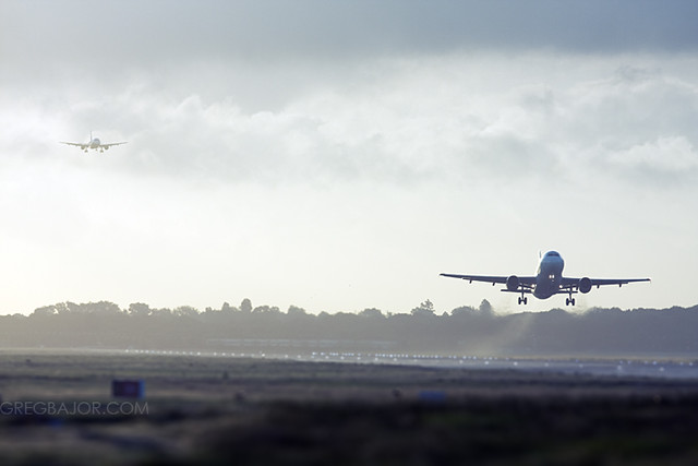 Commercial aircrafts landing and taking off.