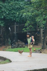 hillside children with chicken