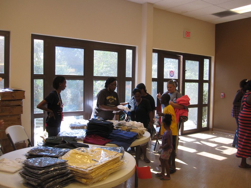 Volunteers passed out nearly 1000 new, donated button down shirts to both children and their parents.