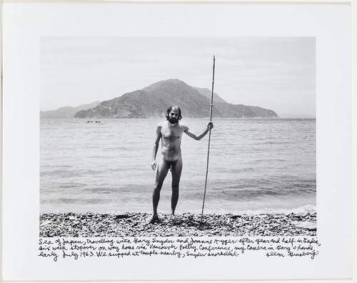 Allen Ginsberg naked holding stick on beach, 1963