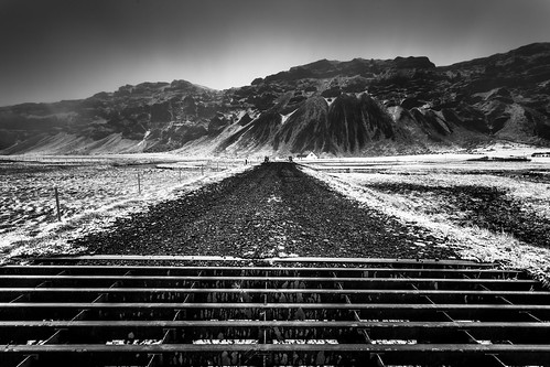 road blackandwhite bw mountain snow mountains ice landscape photography photo iceland rocks europe photographer image fav20 photograph april 100 scandinavia fav30 f11 cattleguard roadscape 17mm fav10 southiceland ef1740mmf4lusm 13sec 2013 southerniceland eos5dmarkiii mabrycampbell april132013 201304130h6a0478