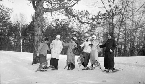 Six girls lifting up their snowshoes, High Park / Six dames soulèvent leurs raquettes à High Park | by BiblioArchives / LibraryArchives