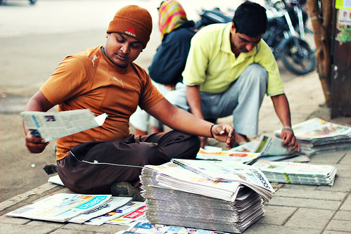 street morning india man newspapers streetportrait stall indians roadside hazy pune streetview newspapervendor sellingnewspaper