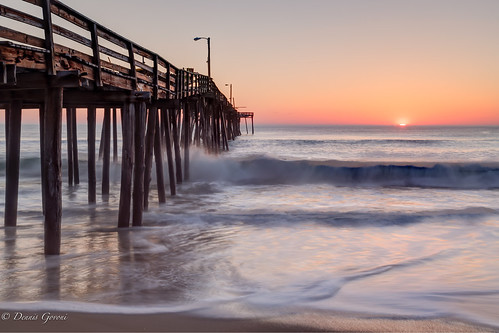 beach landscape nagshead northcarolina ocean outerbanks pier sunrise water unitedstates us