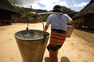 Carrying water in Lao PDR | by DFAT photo library
