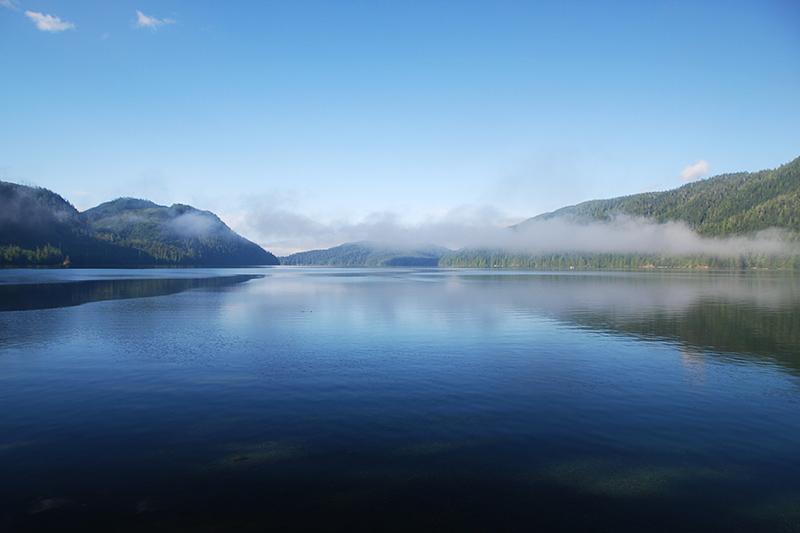 Morning fog lifts at Nitinat Lake, Vancouver Island, British Columbia, Canada