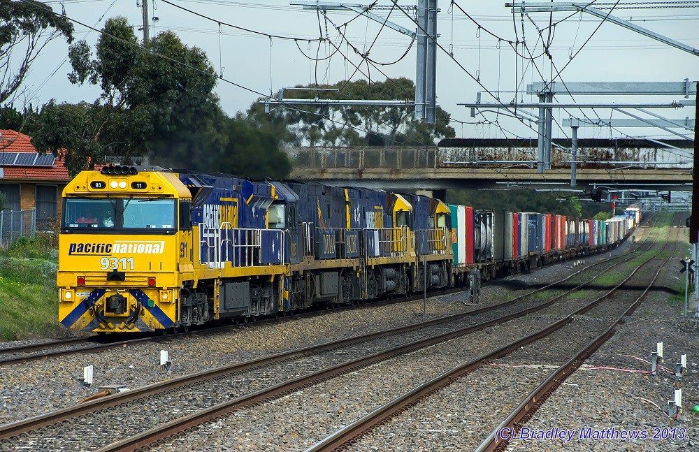 9311-NR25 (IP)-NR30-NR48 with 3MB2 super freight to Brisbane at Coolaroo (17/9/2013) by Bradley Matthews