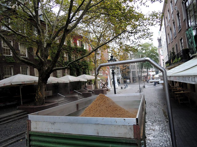 The used grains from the brewery come out this tube into the street where they're collected in the trailor of a tractor by bryandkeith on flickr