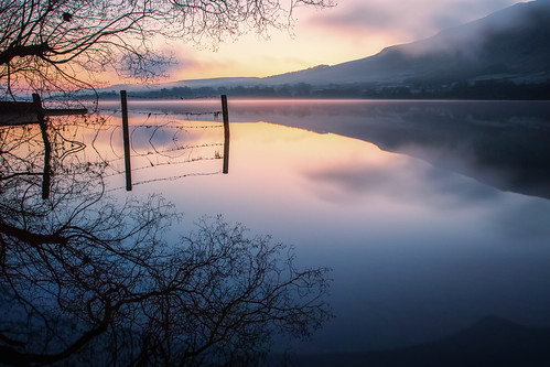 ullswater lake england uk sunrise fence reflection water hills landscape mist silhouette