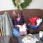 Sarah tearing open her present furiously