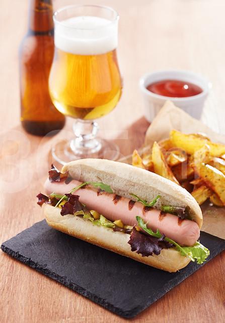 Gourmet hot dog on slate board