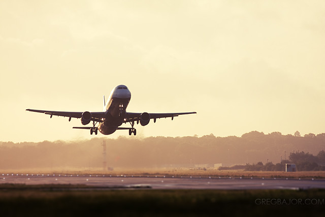 Commercial airliner taking off from runway.