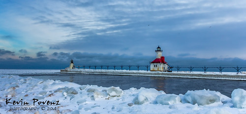 2014 january kevinpovenz lighthousecrawl michigan westmichigan lakemichigan channel lighthouse sunrise water blue snow cold morning stjoseph