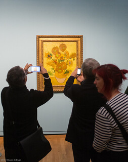 Admiring Sunflowers by VIncent van Gogh