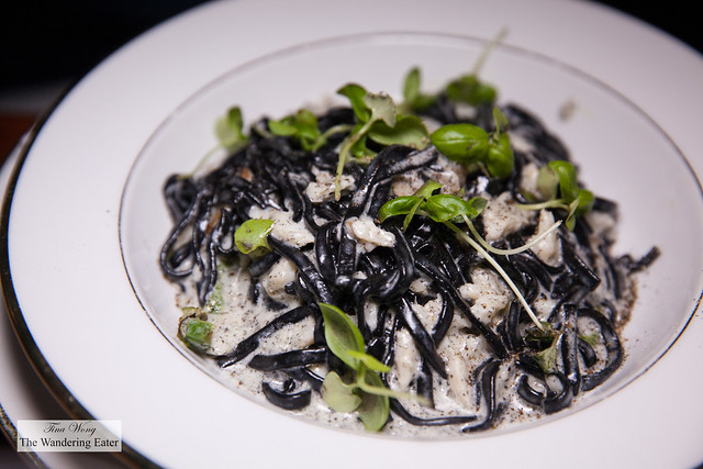 Squid ink linguine with Peekytoe crab, green chile, and cream sauce