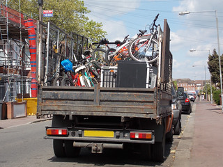 TRUCK LOADED WITH ABANDONED BICYCLES ON AN EAST LONDON BODOUGH SUBURB STREET ENGLAND DSCN0454
