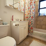 Marble tiling and a built in ledge make this Evanston bathroom f