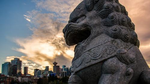 vancouver chineseguardianlions sculpture stone statue skyline sunset crabpark publicart skyscape tourism nikon d7000 dslr downtown harbour