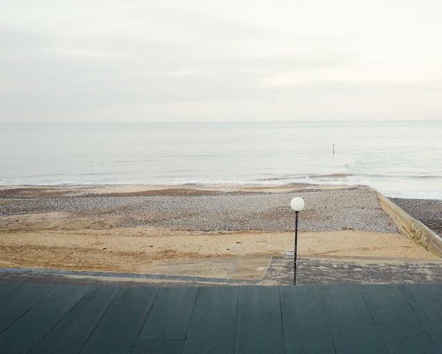 lamp post, beach and sea