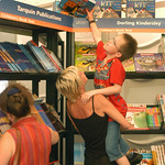 Stretching for a book in the Children's Bookshop |