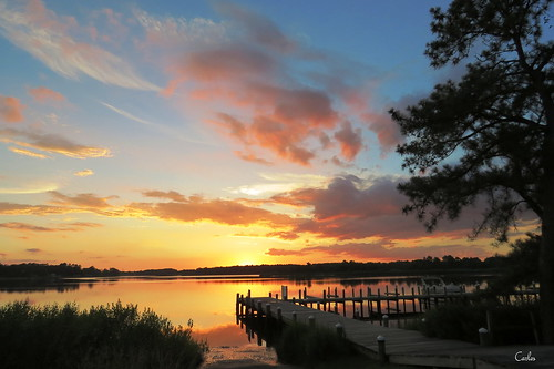 sunset sun water gold dock delaware