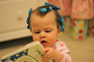 Baby girl reading with hair in curlers | by hayleesherwood
