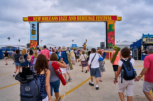 Crowd streams in on April 28 2017 Day 1 of Jazz Fest. Photo by Eli Mergel