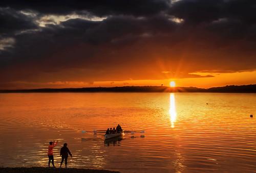 sunset cobh cork ireland tourism water canoe boat orange glow evening dusk canon 80d sunburst april coast shore alanhopps south row rowers rowing loweraghada pier watersports club athletes sunstar reflections sea waterway