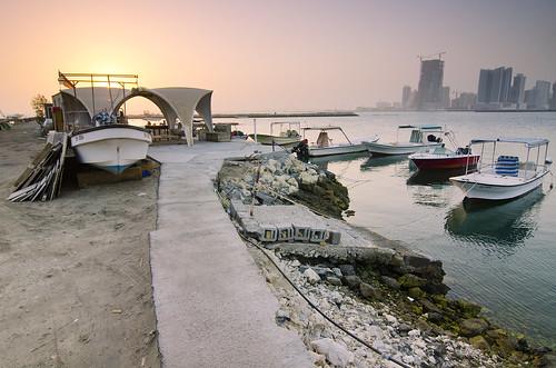 city morning sky water sunrise boats bahrain fishing fisherman industrial cityscape trespassing manama waterscape