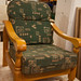 Hardwood armchair green cushions €45