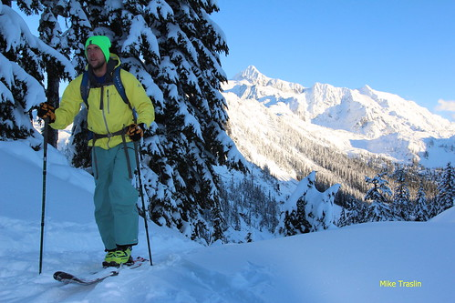 Wed, 2013-11-20 04:03 - Mt Shuksan in the background. Skier Andy Traslin.   photo Mike Traslin