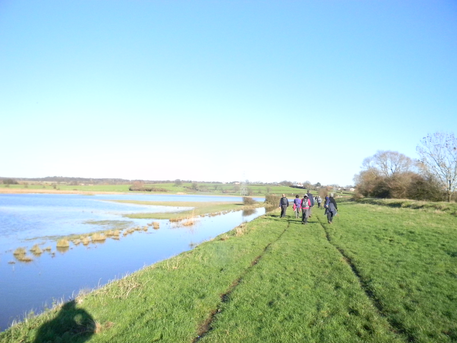 Along a drainage ditch Flooded fields to left Appledore Short Circular