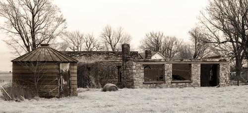 collapsedroof rust haybale grass infrared opendoor nowindows weathered masonry roundthingy winter baretrees