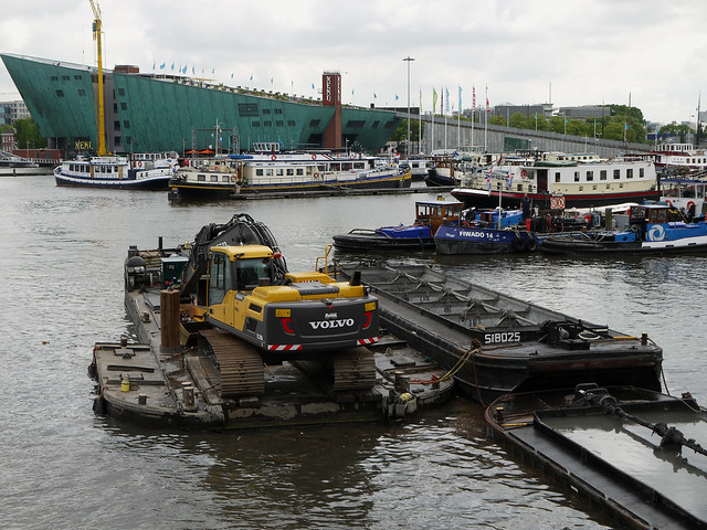 2013.06 - 'View on the NEMO museum', on the horizon to the left and municipal dredge boats in the fore-ground of the Oosterdok; urban photography Amsterdam by Fons Heijnsbroek, Amsterdam