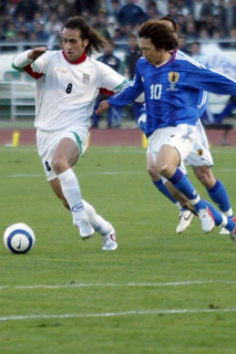 Ali karimi and Nakamura Shunsuke during their the World Cup 2006 qualifying match in Tehran